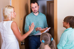Desperate family and irritated inspector Royalty Free Stock Image
