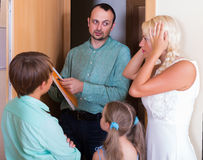 Desperate family and irritated inspector Royalty Free Stock Photography