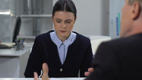 Desperate female leaving office tired of shouting boss, psychological pressure. Stock footage stock video