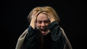 Desperate female screaming in sorrow, suffering mental disorder, nightmare. Stock footage stock video