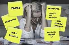 Desperate and frustrated blond caucasian family woman domestic accounting worried about money paying taxes calculating expenses an. D payments suffering stress royalty free stock images