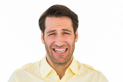 Desperate handsome man frowning at camera Royalty Free Stock Photo