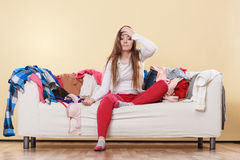 Desperate helpless woman in messy room home. Stock Photo