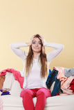 Desperate helpless woman in messy room home. Royalty Free Stock Photography