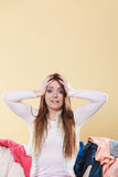 Desperate helpless woman in messy room home. Royalty Free Stock Image