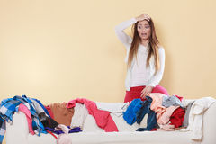 Desperate helpless woman in messy room home. Royalty Free Stock Images