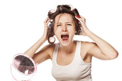 Desperate with her hair curlers Royalty Free Stock Image