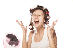 Desperate with her hair curlers Stock Image