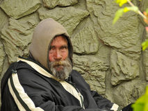 Desperate Homeless Man. Desperate Looking Homeless Man Searching for a Place to Stay Stock Image