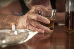 Desperate, lonely alcoholic man Stock Photography