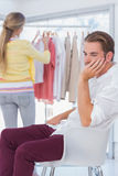 Desperate man being bored while his girlfriend is shopping Stock Photography