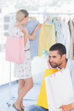 Desperate man being bored while his wife is shopping Royalty Free Stock Photography