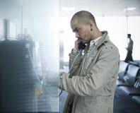 Desperate man calling Stock Image