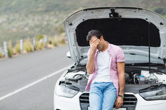 Desperate man after a car breakdown. At the side of the road Stock Photo