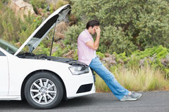 Desperate man after a car breakdown. At the side of the road stock images