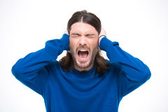 Desperate man closed ears by hands and screaming Stock Image