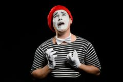 Desperate man crying. And looking up. Waist up portrait of male mime artist, asking why, expressing sadness and disappointment. Dramatic performance royalty free stock photography