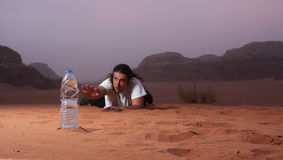 Desperate man in the desert longing for water royalty free stock photos