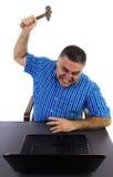 Desperate man destroys the laptop. Caucasian man in despair smashes the laptop Royalty Free Stock Photos