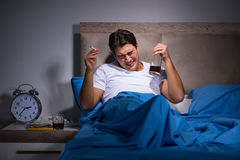 The desperate man divorced in bed Royalty Free Stock Photos