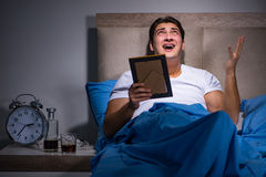 The desperate man divorced in bed Stock Photography