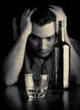 Desperate man drinking alone Royalty Free Stock Photos