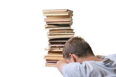 Desperate man in front of books pile Stock Image