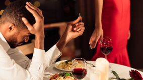 Free Desperate Man Holding Ring After Refuse Of Proposal In Restaurant Royalty Free Stock Images - 170119039