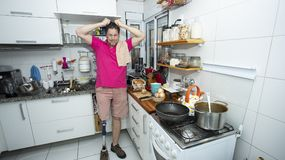 Desperate man in the kitchen, Cleaning concept royalty free stock photo