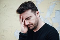 Desperate man lost in depression suffering emotional pain stock photo