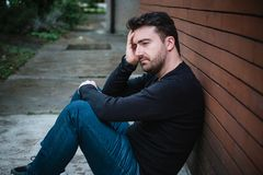 Desperate man lost in depression suffering emotional pain royalty free stock photo