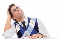 Desperate man with neck pain in pullover reading book Royalty Free Stock Photography