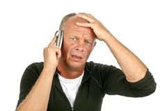 Desperate man on the phone Stock Photography