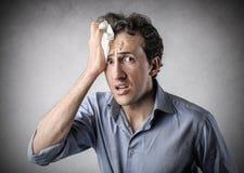 Desperate man sweating Stock Image