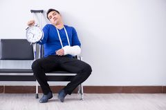 Desperate man waiting for his appointment in hospital with broke. N arm Royalty Free Stock Photos