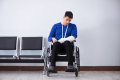 Desperate man waiting for his appointment in hospital with broke. N arm Royalty Free Stock Photography