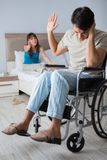 The desperate man on wheelchair with his sad wife. Desperate men on wheelchair with his sad wife Royalty Free Stock Photo