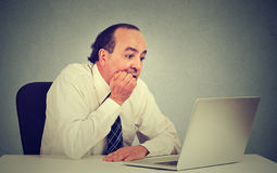 Desperate middle aged employee man working on computer in his office Royalty Free Stock Image