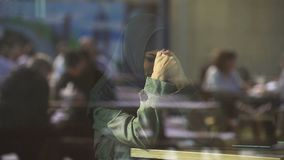 Desperate Muslim female crying in cafe, suffering loneliness, ashamed of divorce. Stock footage stock footage