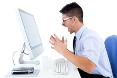Desperate office worker with computer Royalty Free Stock Images