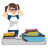 Desperate Packing Suitcase. Desperate young woman packing overfilled suitcase with clothing Stock Photo