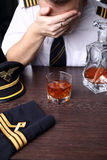 Desperate  pilot drink alcohol Stock Images