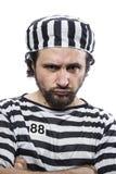 Desperate, portrait of a man prisoner in prison garb, over white Stock Images