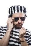 Desperate, portrait of a man prisoner in prison garb, over white Stock Photos