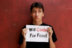 Desperate Programmer. A desperate programmer holding a sign to ask for job stock photography