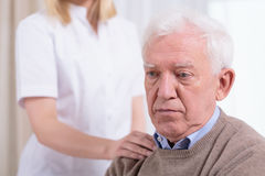 Desperate sad pensioner Royalty Free Stock Image