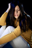 Desperate sad woman crying in the dark Royalty Free Stock Photography