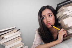 Desperate school girl looking up thinking Stock Images