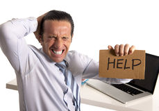 Desperate senior businessman in crisis working on computer at office in stress Stock Photo