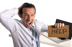 Desperate senior businessman in crisis working on computer at office in stress Stock Photography